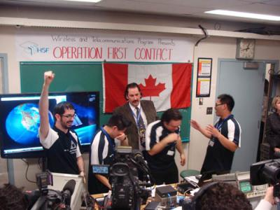 From left, Patrick Neelin, Paul Je, Gino Cunti and Kevin Luong, with their professor Mark Rector, are overcome after their successful contact with the space station.